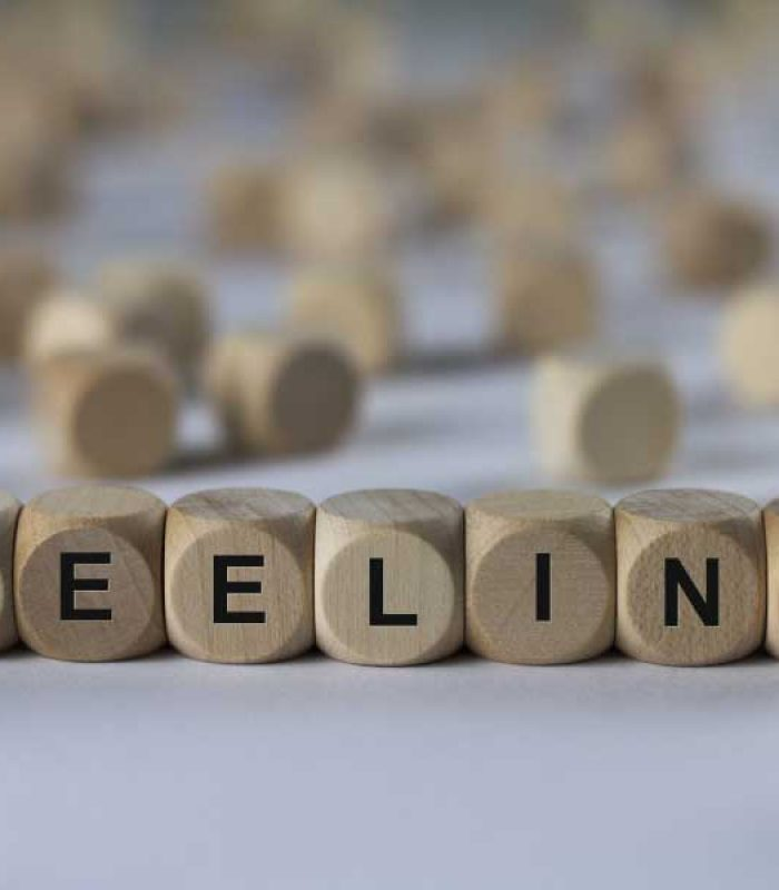 feeling - cube with letters, sign with wooden cubes